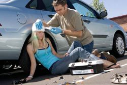 "Male first aider assisting female motor vehicle accident victim. - Right click and choose ""Save As"" to download."