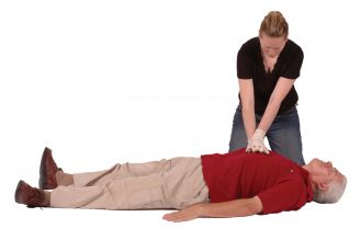 Woman performs Cardiopulmonary Resuscitation on a unresponsive man.
