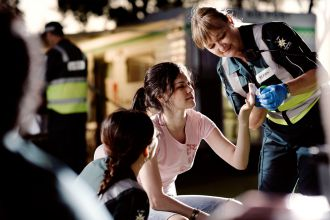 St John Ambulance Australia (WA) volunteer providing first aid.
